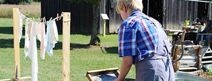 Heritage Festival participant washes clothes