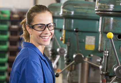 Female machinist in blue coverall