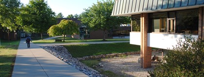 Student walking on MCC's Sidney campus